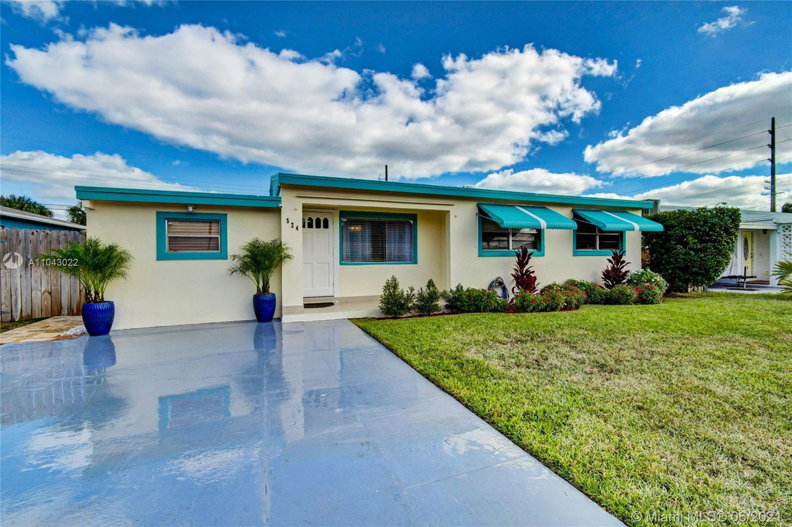 Beautifully renovated property features 4/2 main house, 1/1 guest house, Large Island eat-in kitchen