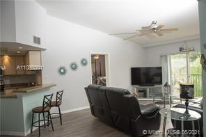 The unit features bright and open sun-filled rooms. Remodeled kitchen with granite countertop, new f