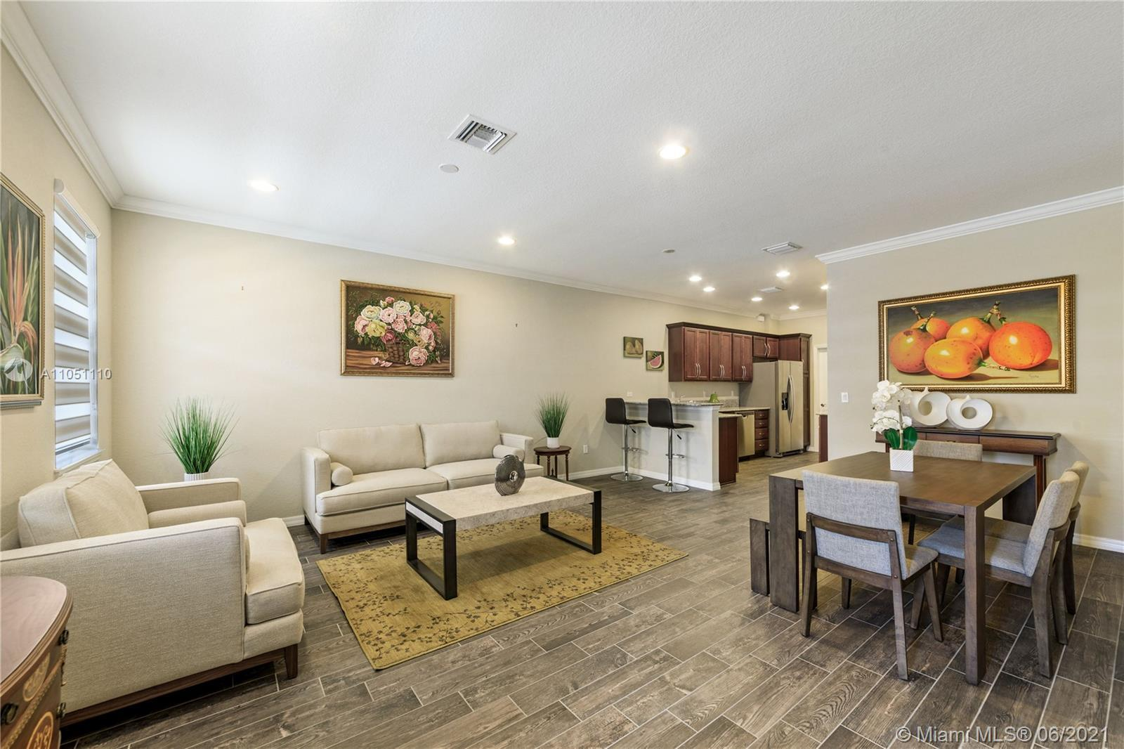 WELCOME TO HOLLYWOOD'S NEWEST GATED COMMUNITY! THIS MAGNOLIA MODEL TOWNHOME OFFERS 3 BEDROOMS AND 2.