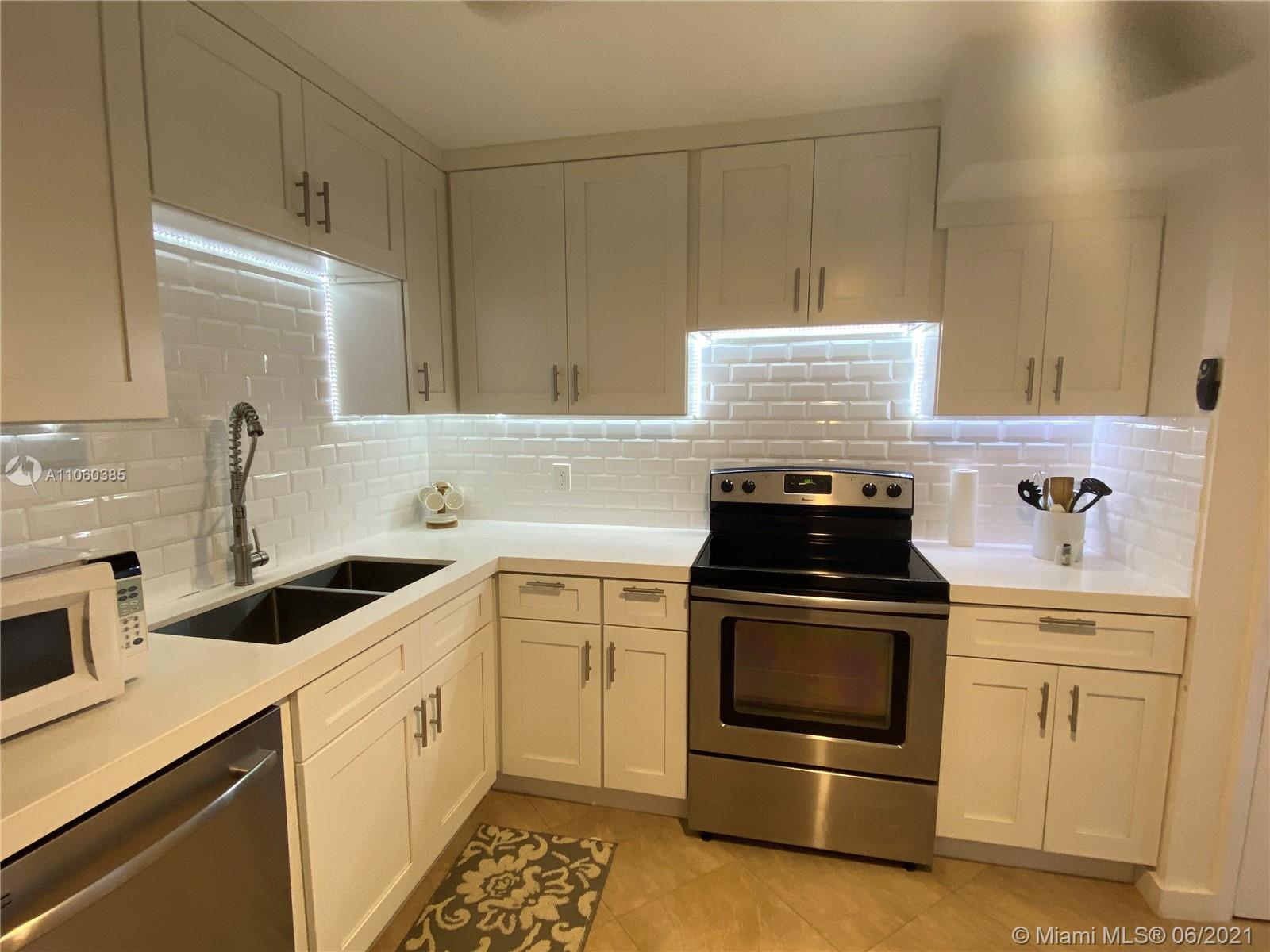 Rarely available completely renovated apartment, a true gem in the heart of Hallandale! Boutique wat