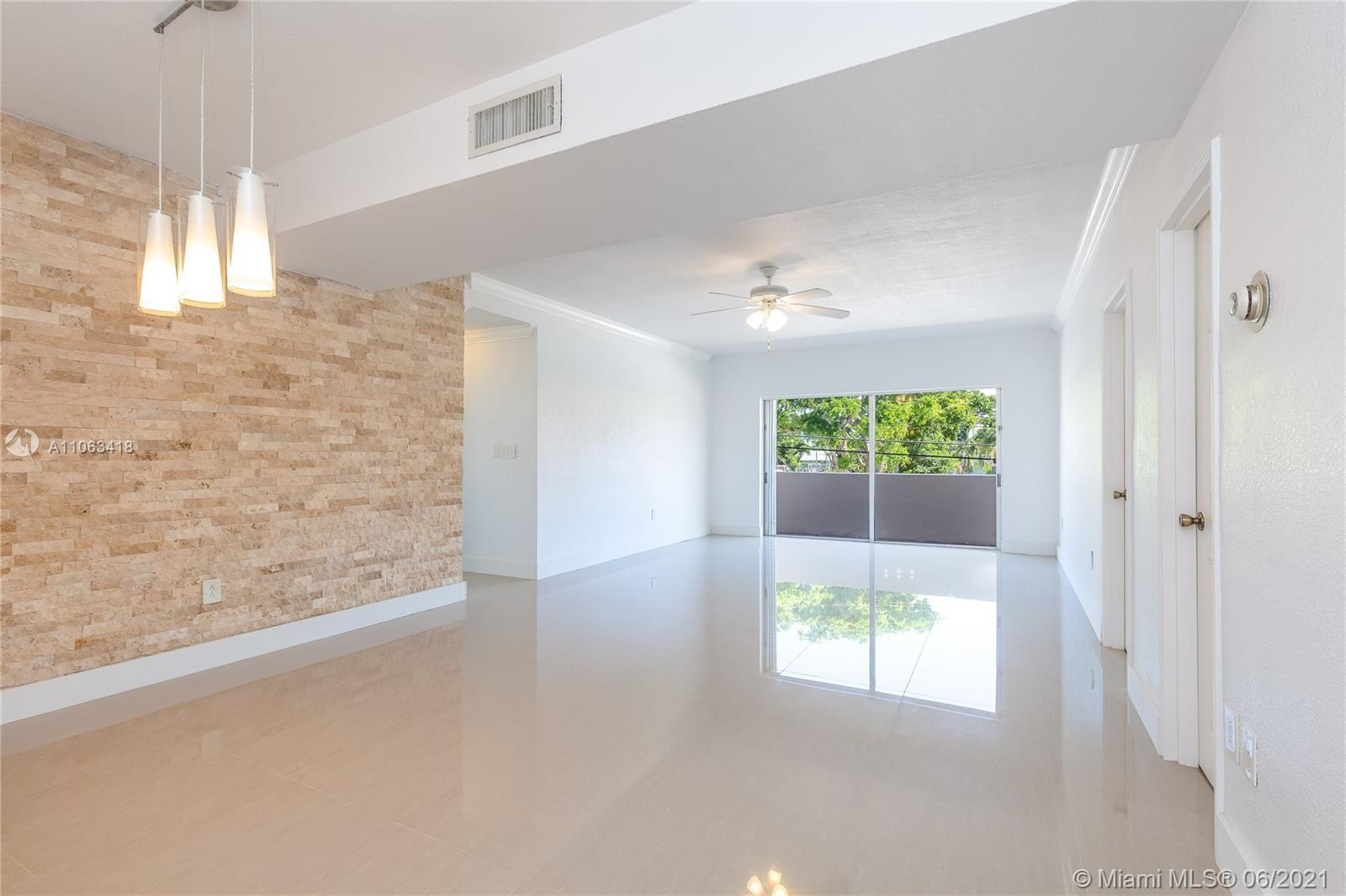 Beautiful and spacious 3 bedroom 2 bathroom remodeled corner unit in a charming, boutique and secure