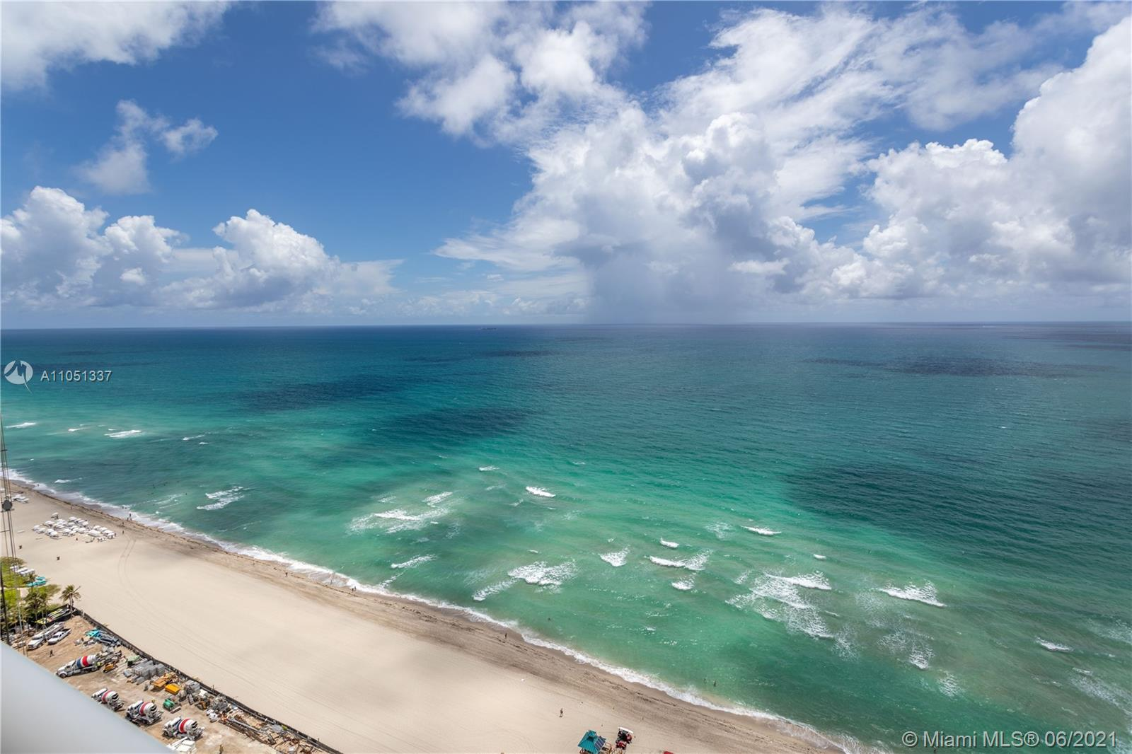 Acqualina is an ocean front unit with world -class services and amenities  Garden areas,private bea