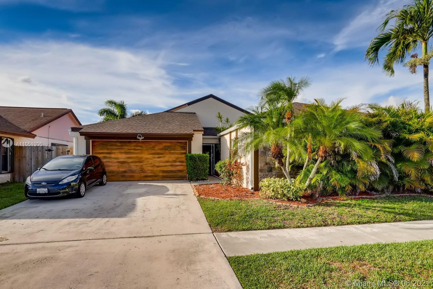 Completely renovated. Pass the tropical landscaping and screened-in porch on your way inside, where