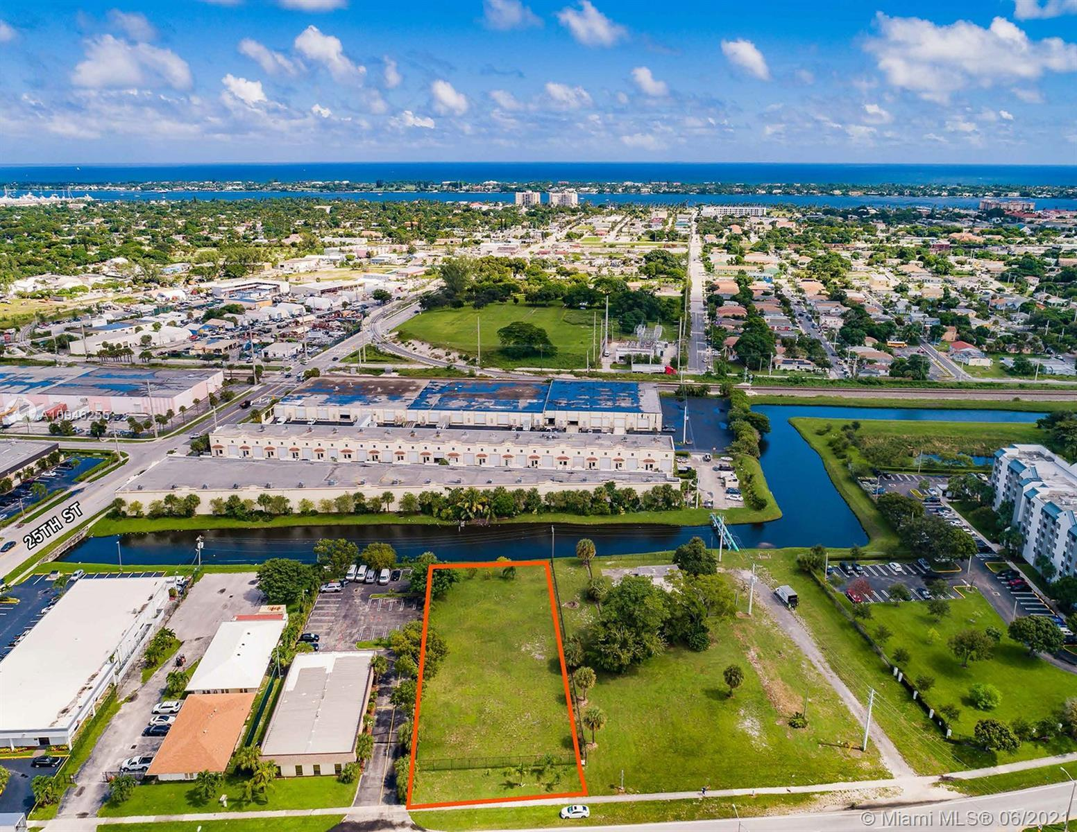 Exclusively presenting for sale a prime vacant lot of 28,400 SF at 2460 N Australian Ave in West Pal