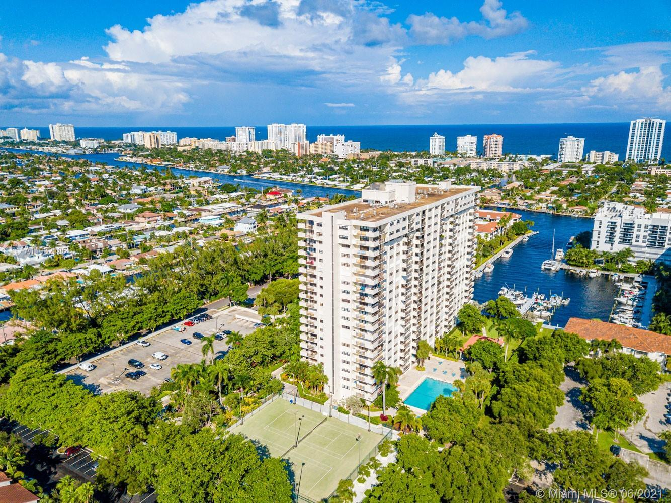THREE BEDROOM CORNER UNIT FACING SOUTH EAST WITH DIRECT OCEAN, INTRACOASTAL AND MARINA VIEWS with wr