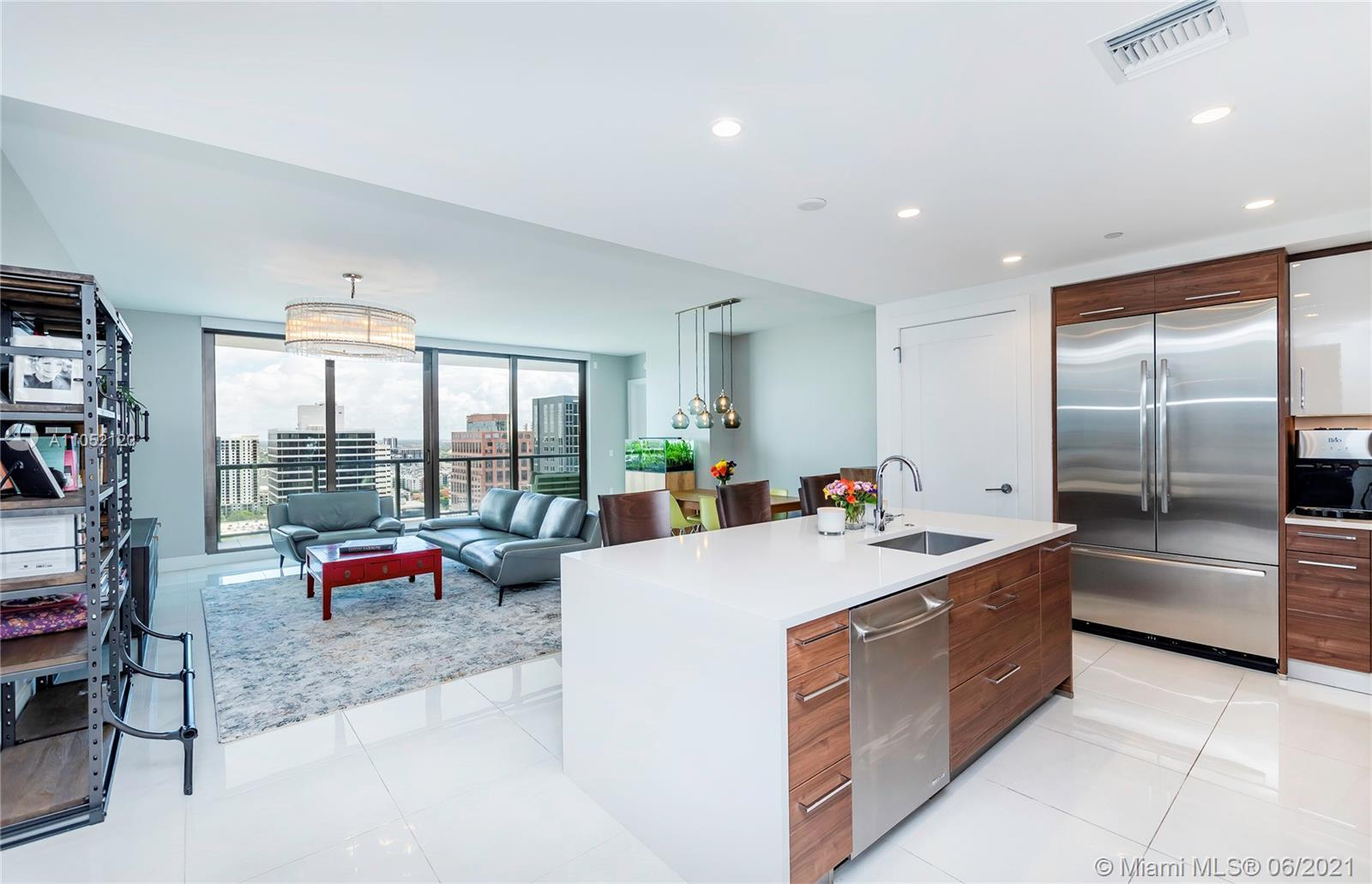 *2 INDIVIDUAL ASSIGNED PARKING SPACES* Beautiful 2 Bed + Den/2.5 Bath unit with 310 SF balcony. Floo