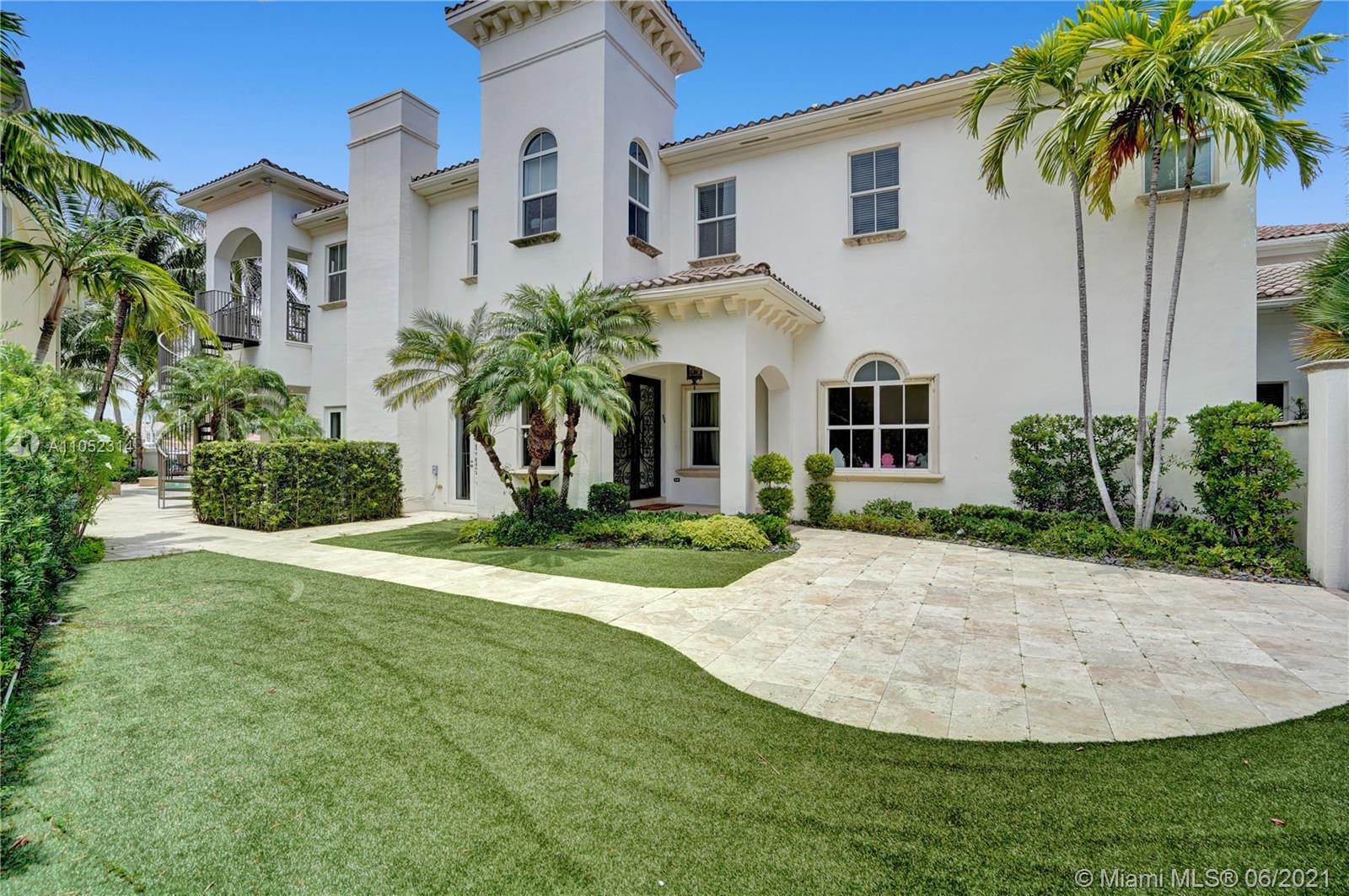 Located in the prestigious gated community of Harbor Islands, this luxury estate has 6 bedrooms each