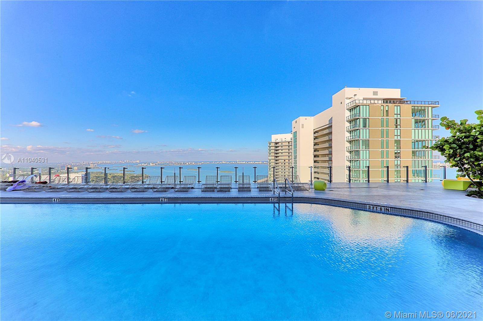 Step into PARADISE!! Fantastic 2 Beds/2 Bath plus Den at the Paraiso Bayviews Condo!! 12 feet High C
