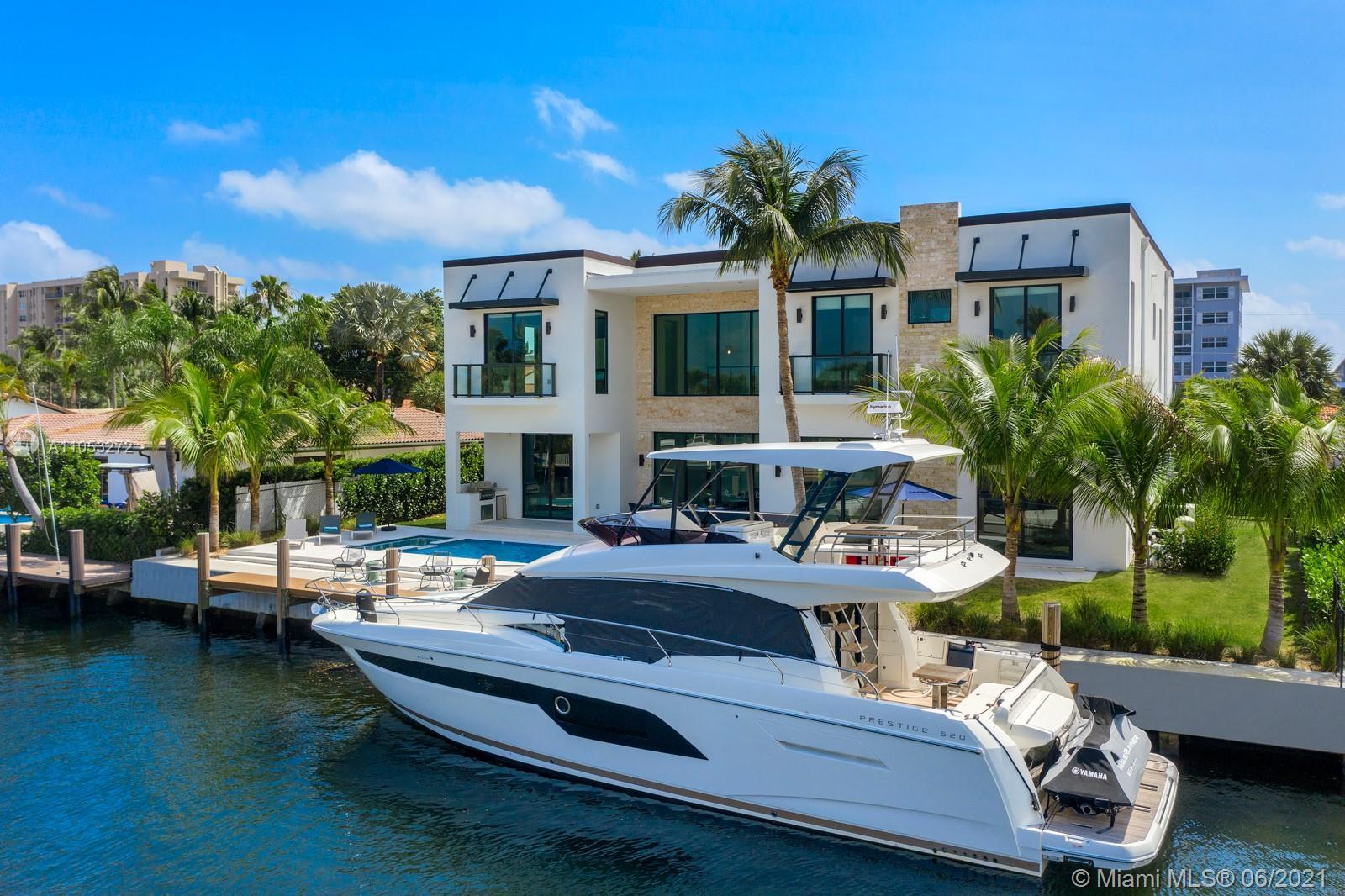 This modern new waterfront home was built in 2021 and decorated by famous BBH design.  Residence fea