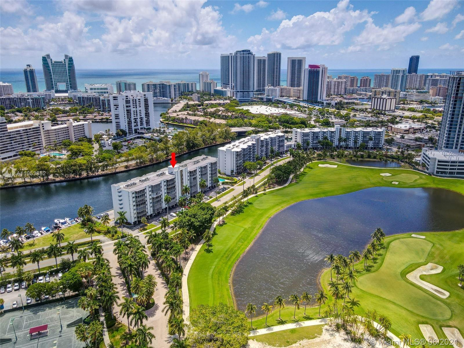 PENTHOUSE UNIT WITH REMARKABLE VIEWS OF THE DIPLOMAT GOLF AND COUNTRY CLUB. SPLIT FLOOR PLAN WITH TW