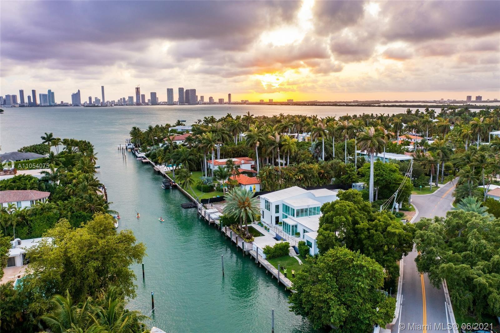 170 ft of private waterfront w/ direct access to open Biscayne Bay. Oversized 14,875 Ft lot rarely a