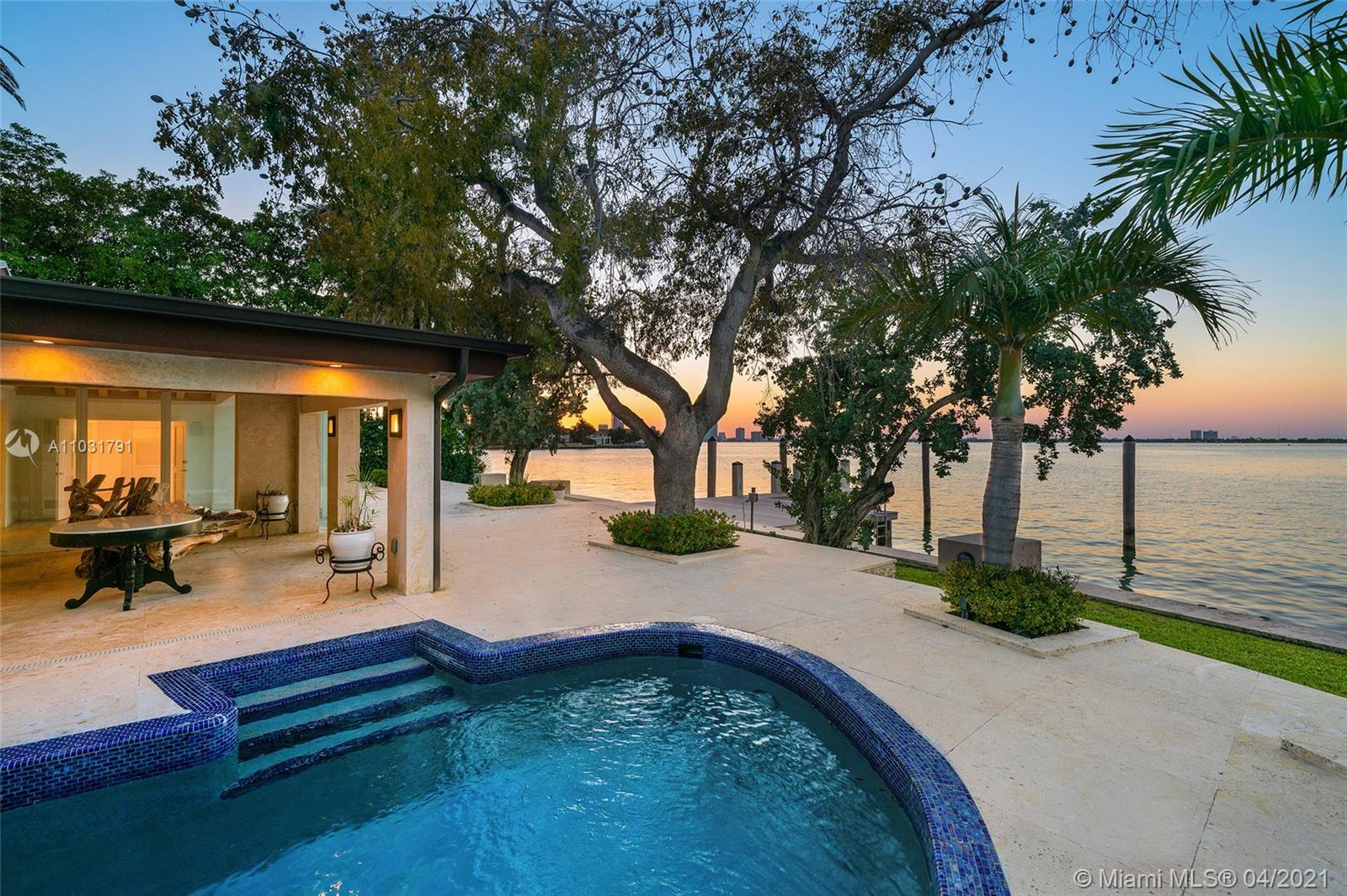 This Bayfront home is perfectly located on the coveted tip of the Venetian Islands. The 5BR/5BA home