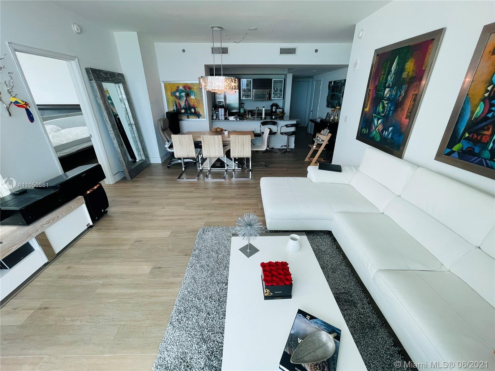 Spacious 2 bed /2.5 bath corner unit with amazing Biscayne Bay views. Residence features modern high