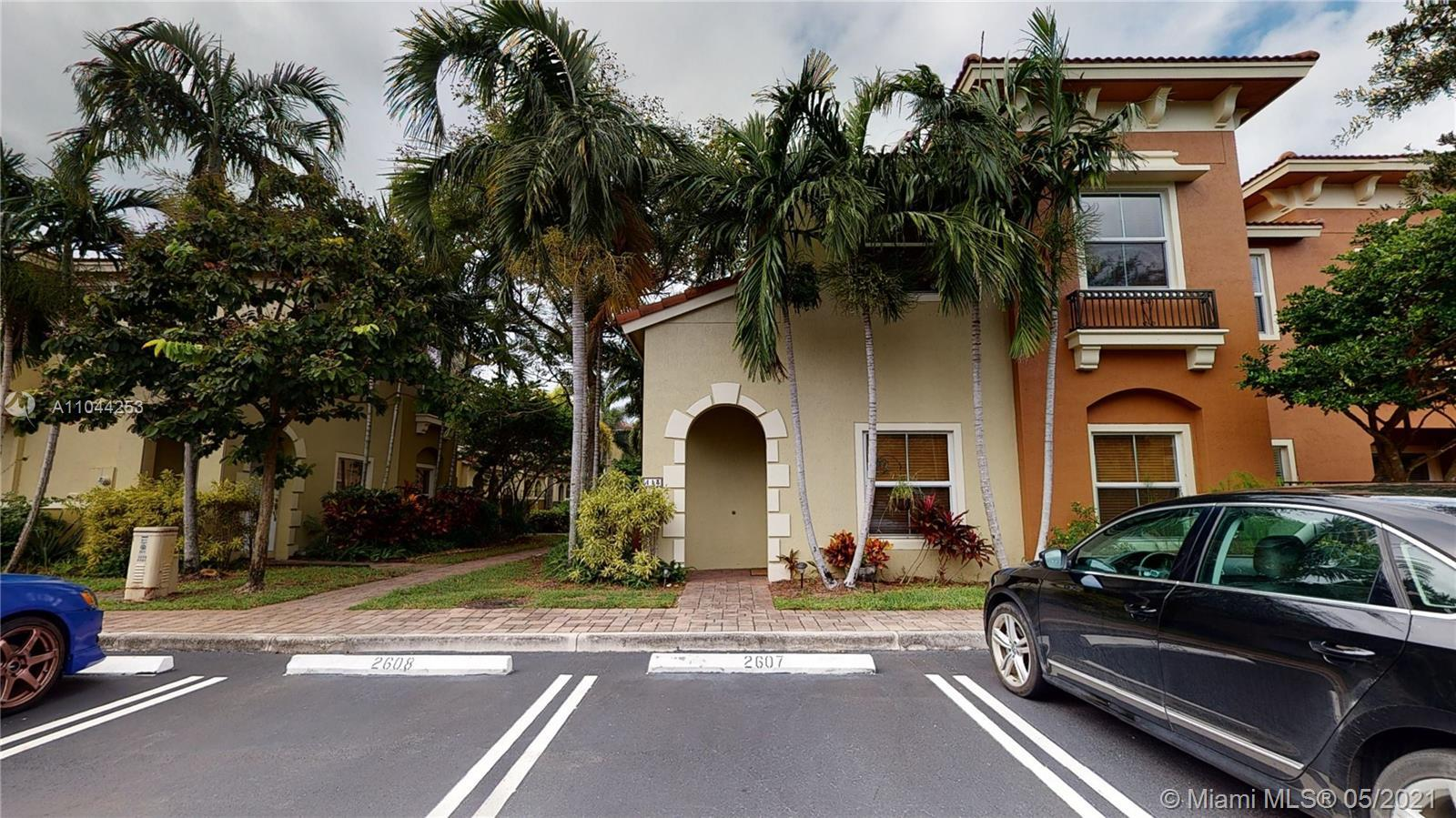 Impeccably upgraded corner townhome in private and gated community. The home boasts real wooden floo
