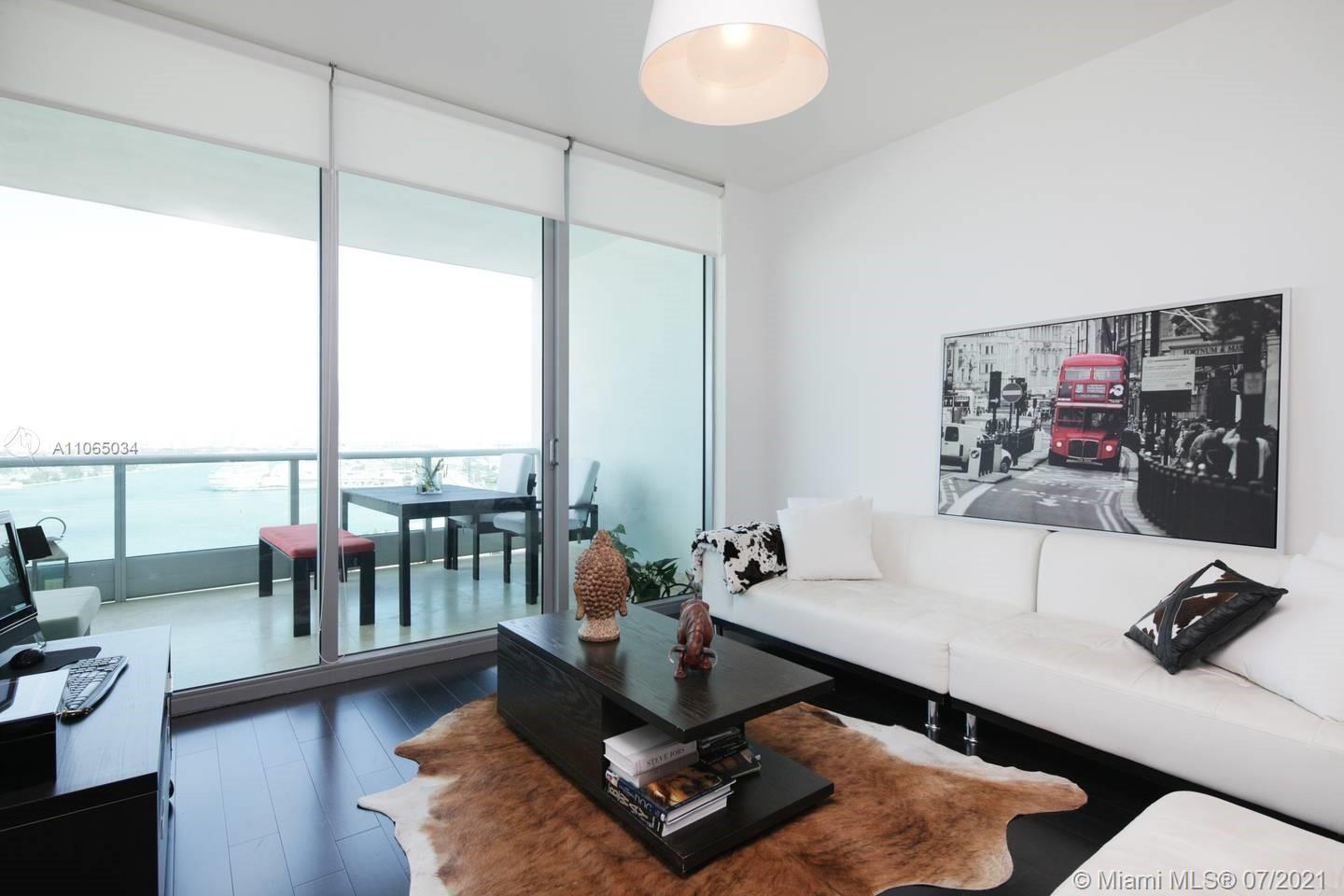 ENJOY IMPRESSIVE MIAMI VIEWS, DIRECT OCEAN AND STUNNING BAY VIEWS FROM THE PRIVATE WIDE BALCONY OF T