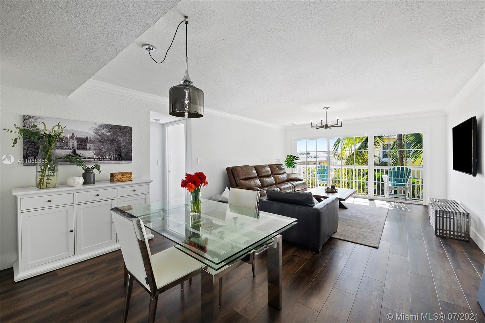 This captivating top floor corner unit has been completely remodeled and is ready for its new owner.