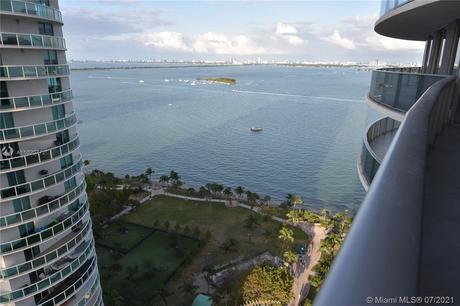 Bask in magnificent water views from every corner of this unit on the '11 line at Aria on the Bay, t