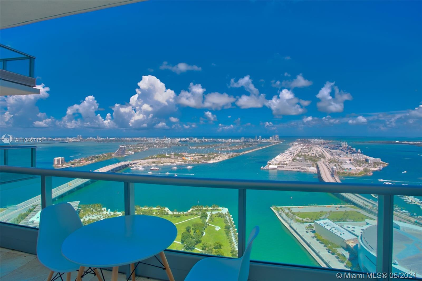 Ultra-luxurious 3 bedrooms 3 bath condo soaring 55 floors above Miami with truly spectacular unobstr