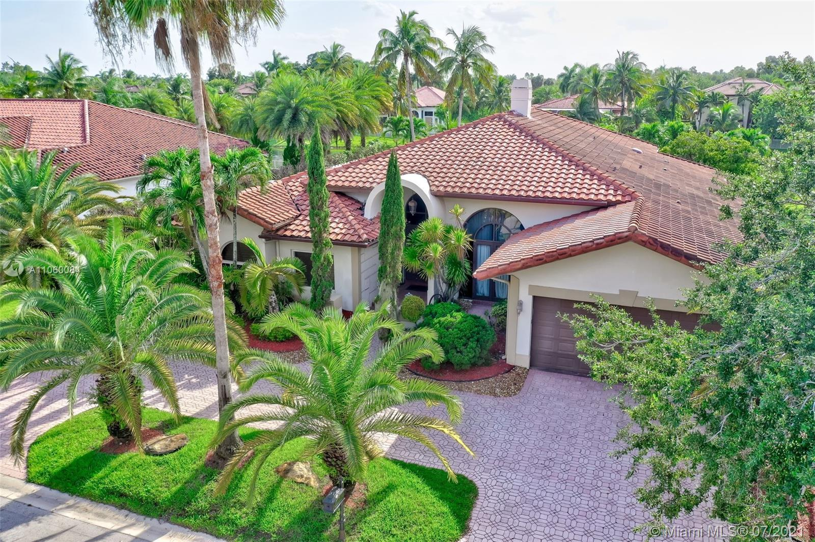 Beautiful home with impressive soaring high vaulted ceilings. This beautiful home sits on a waterfro