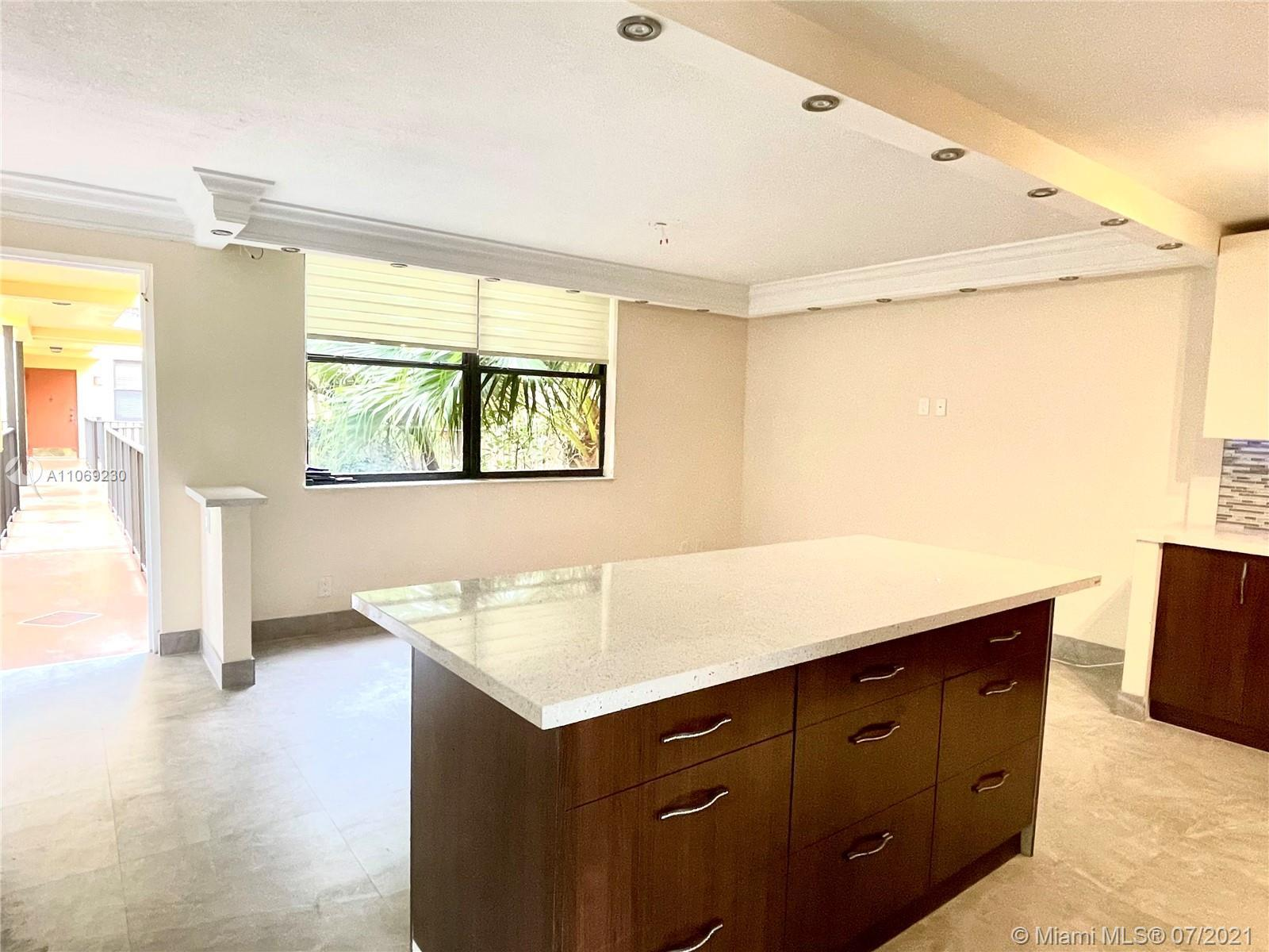 Substantially Remodeled spacious 3BDR/2 BTH located in boutique tranquil & private gated building in