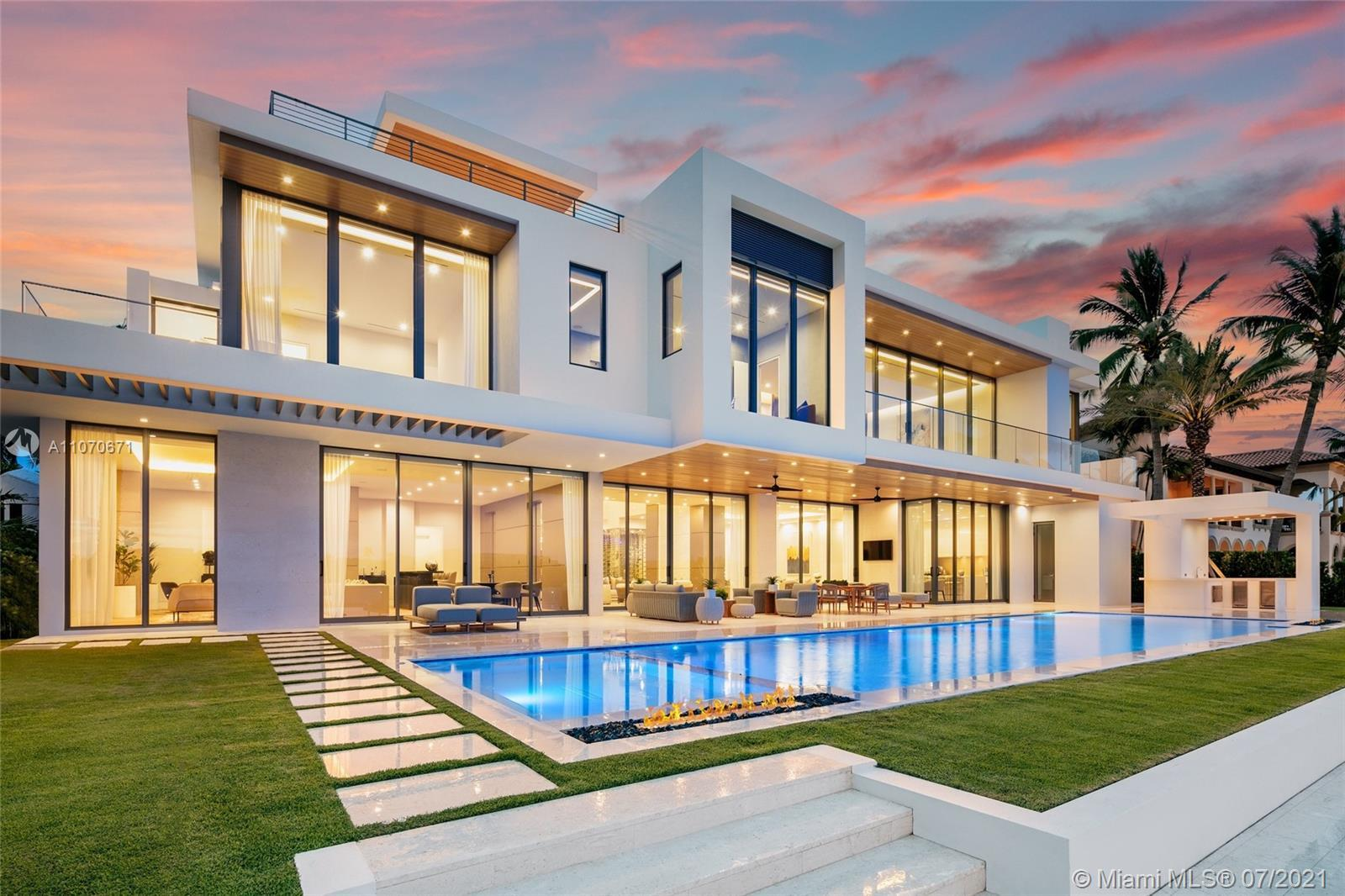 This stunning modern masterpiece boasts 6 beds, 7 full baths & 2 half baths in the highly sought aft
