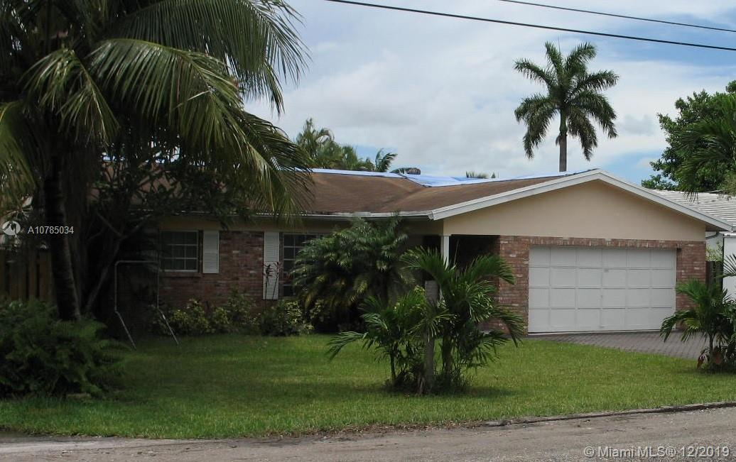 AMAZING INVESTMENT OPPORTUNITY.  RARELY AVAILABLE THREE BEDROOM, TWO BATH HOUSE ON 60 FEET OF WATERF