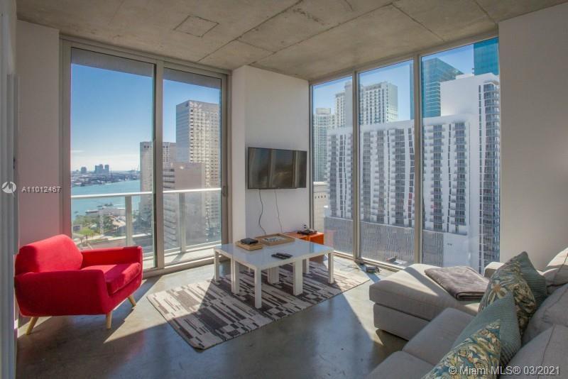 Modern and very convenient 2 bed / 2 bath corner unit at Centro Loft Condo with an impressive city v