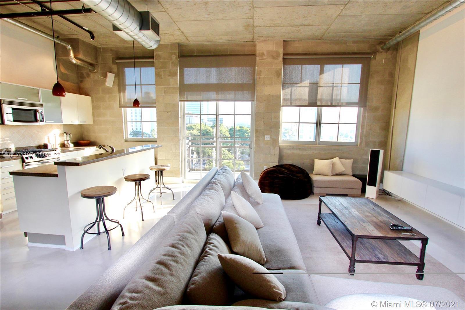 Stunning Industrial Loft in FAT Village, Fort Lauderdale's hottest area. Enjoy the open floor plan,