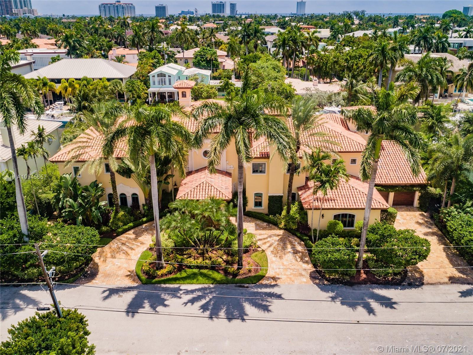 Stunning custom trophy estate located on one of the finest South Las Olas Isles & close to the point