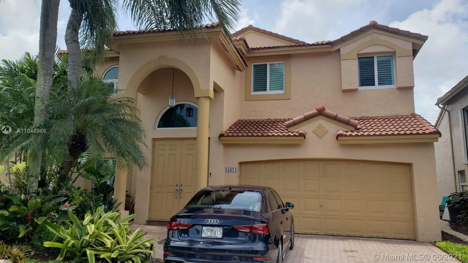 Beautiful Updated and remodeled home in Grand Palms Golf Course. Light gray wood looking tile downst