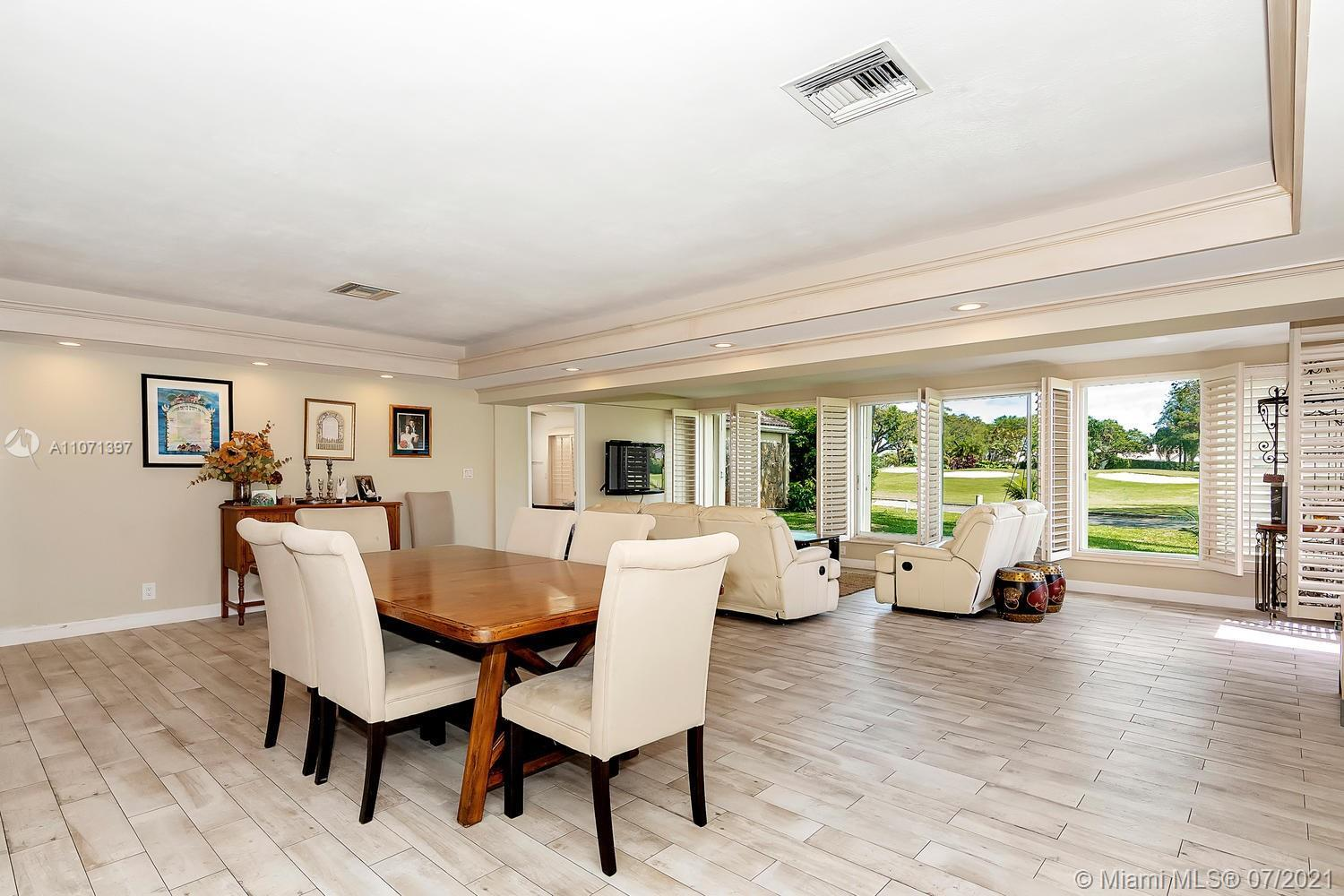Welcome to this stunning Golf Course Villa surrounded by gracious, mature oak trees. This home will