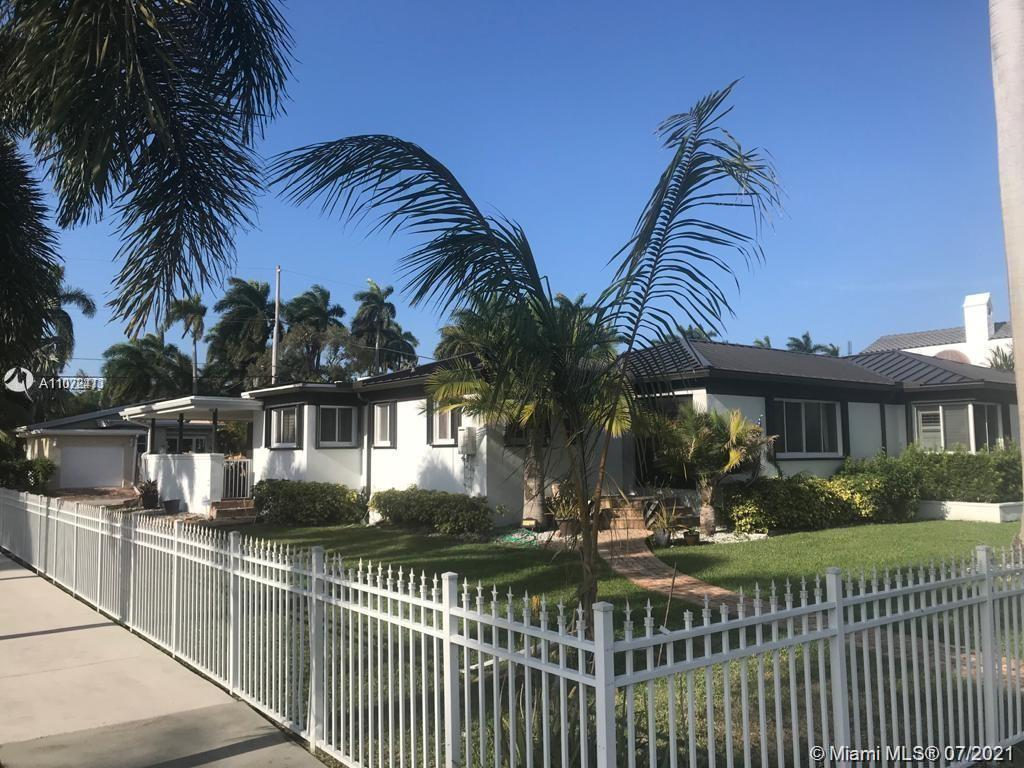 """Gorgeous Hollywood Lakes Home on a corner double lot 100'X 121"""" features an amazing backyard with co"""