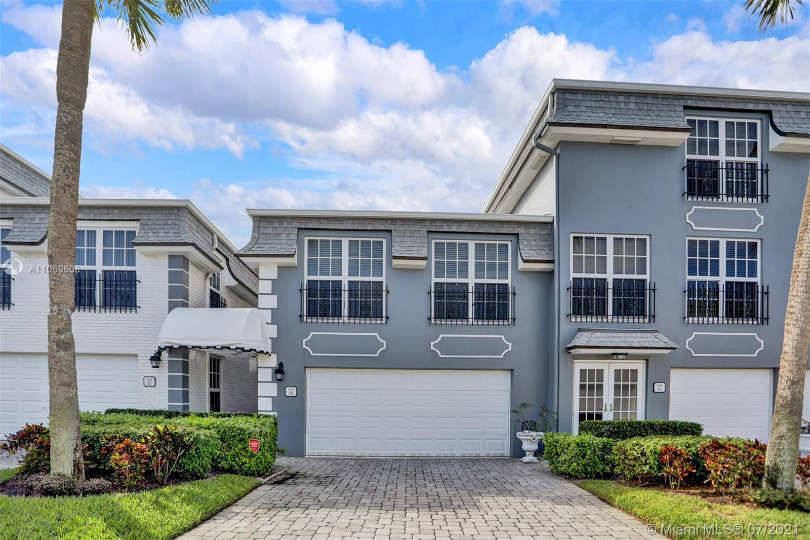 Exclusive community on Hillsboro Mile. Updated and spacious 2 level villa located across the beach.