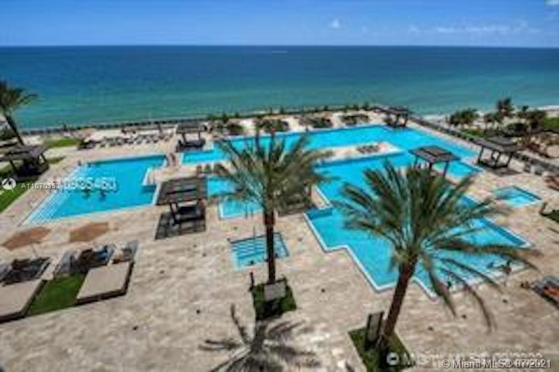 Beautiful NE corner unit in Beach Club Tower Three with direct ocean view overlooking the pools plus