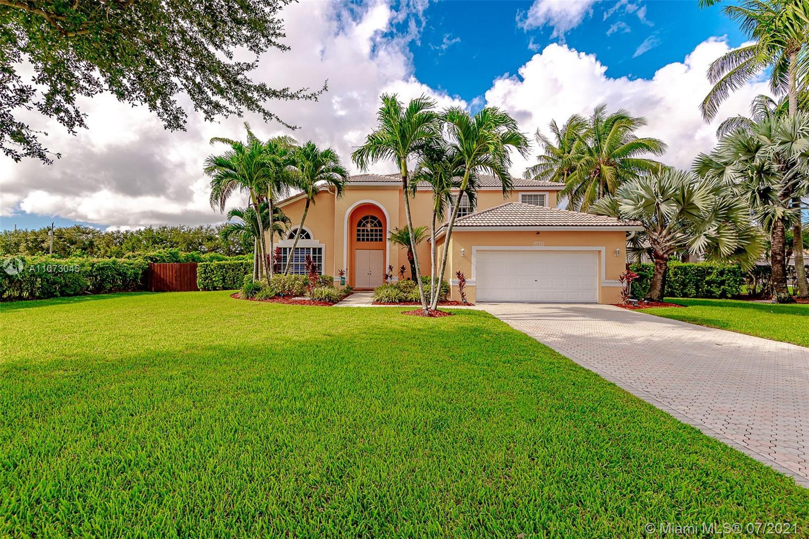 Rarely available 5/3 with Pool in heavily sought after Cypress Lake Estates in Wellington blocks fro