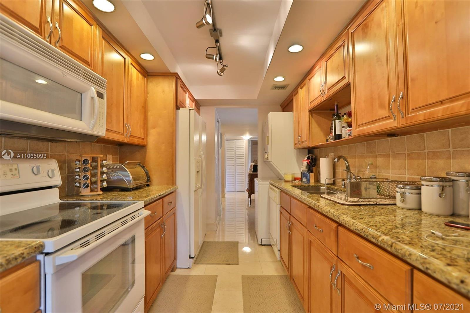 STUNNING CORNER UNIT. Very spacious (2 bed + 2 baths + eat-in breakfast/office area). One of the bes