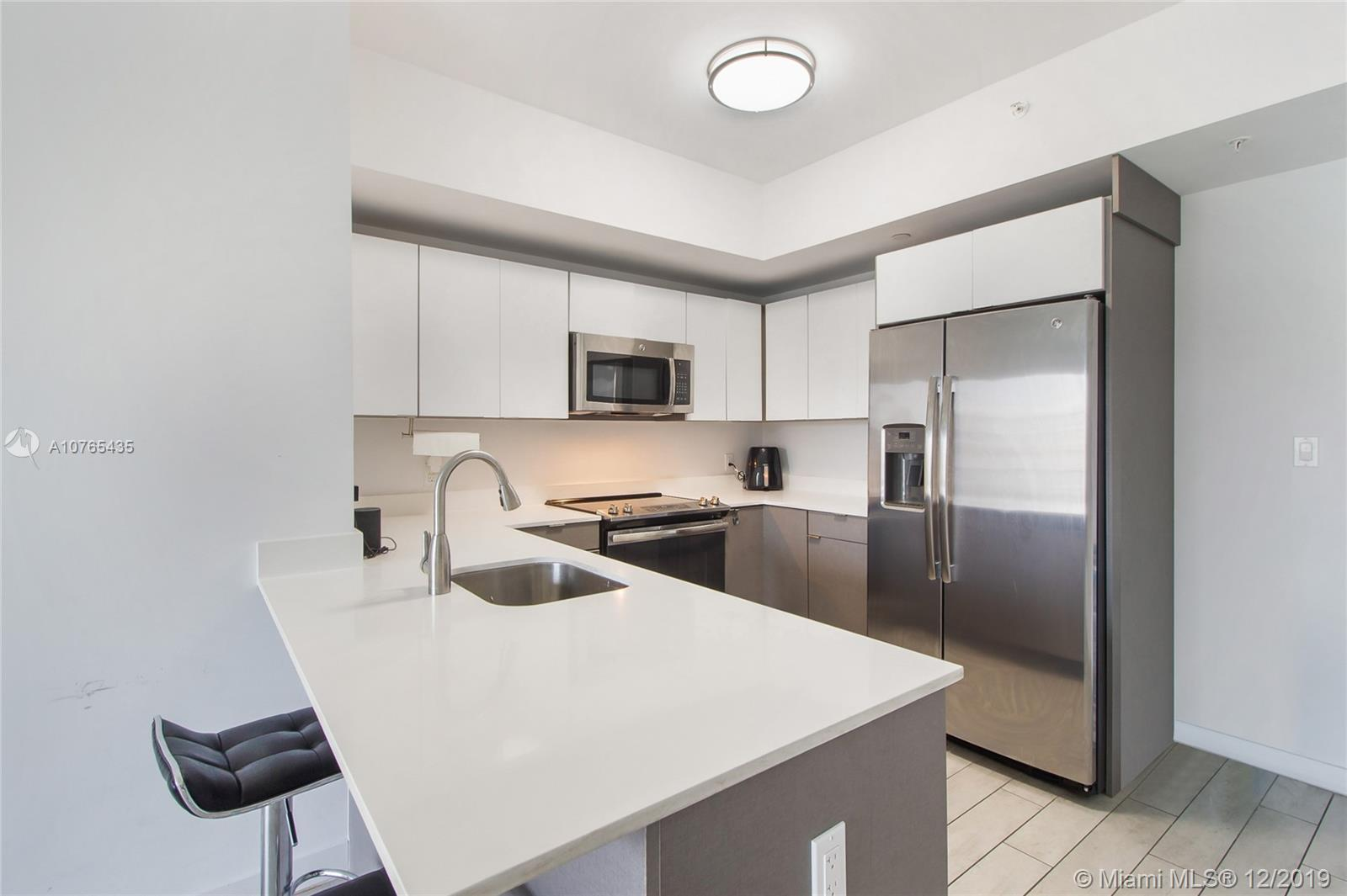 **GREAT INVESTOR OPPORTUNITY**Unit is rented for $1,950 a month until FEB 2022! Low Maintenance Fee!