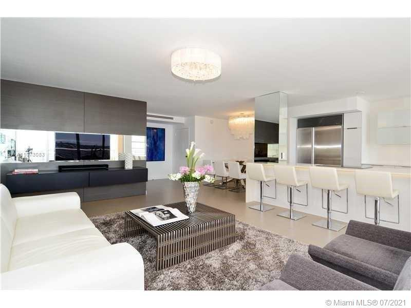 SELLER WILL FINANCE! Stunning and sophisticated 2 bedroom/2 bathroom waterfront condo with top desig