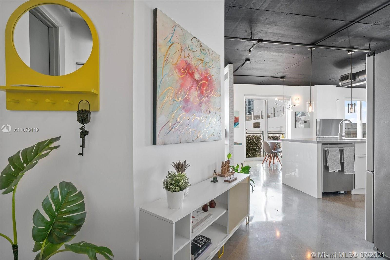 Enjoy Bay and City views from this impressive, industrial loft style apartment, located in the Edgew