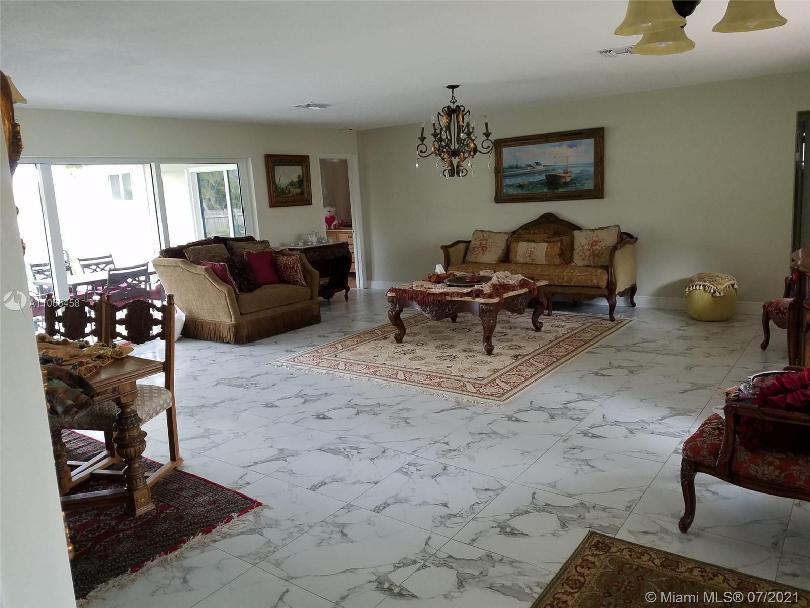 SURROUNDED BY MILLION DOLLAR HOMES ON THE 800 BLOCK OF WASHINGTON ST IN HOLLYWOOD LAKES THIS 3 BD/ 2