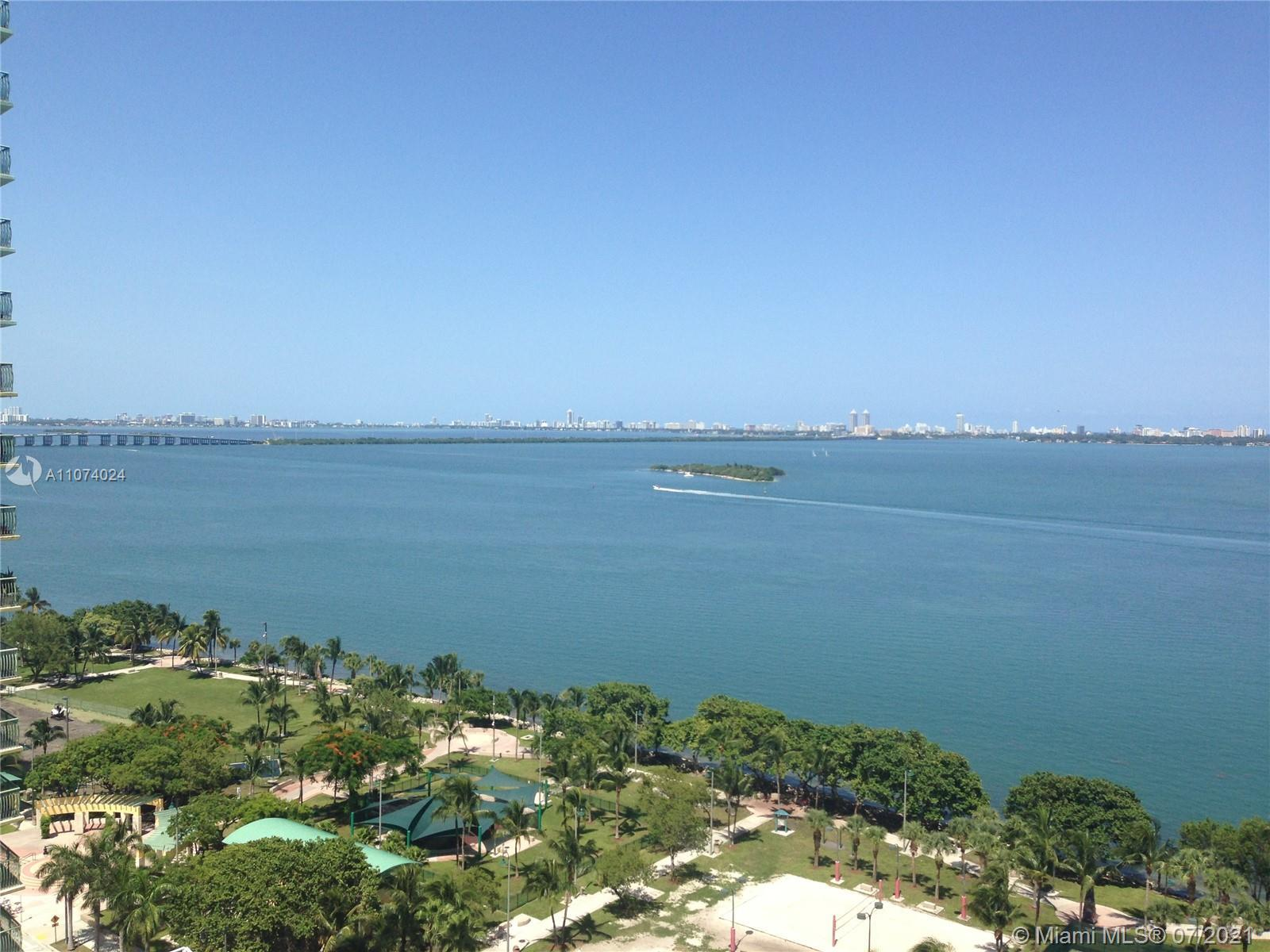 """Unobstructed panoramic water view in the the most sought-after """"01"""" linen the building. The Opera To"""