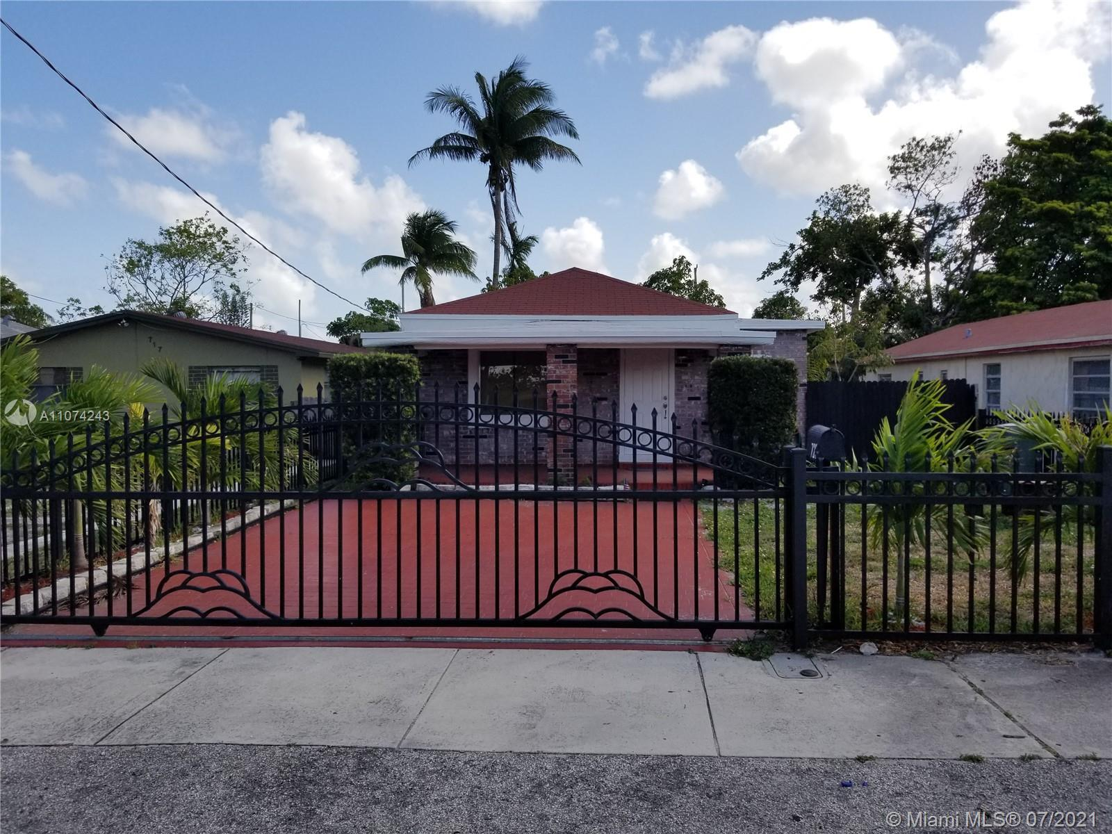 Beautifully renovated 3 bedroom 2 bathroom single family home with wood floors throughout, newer app