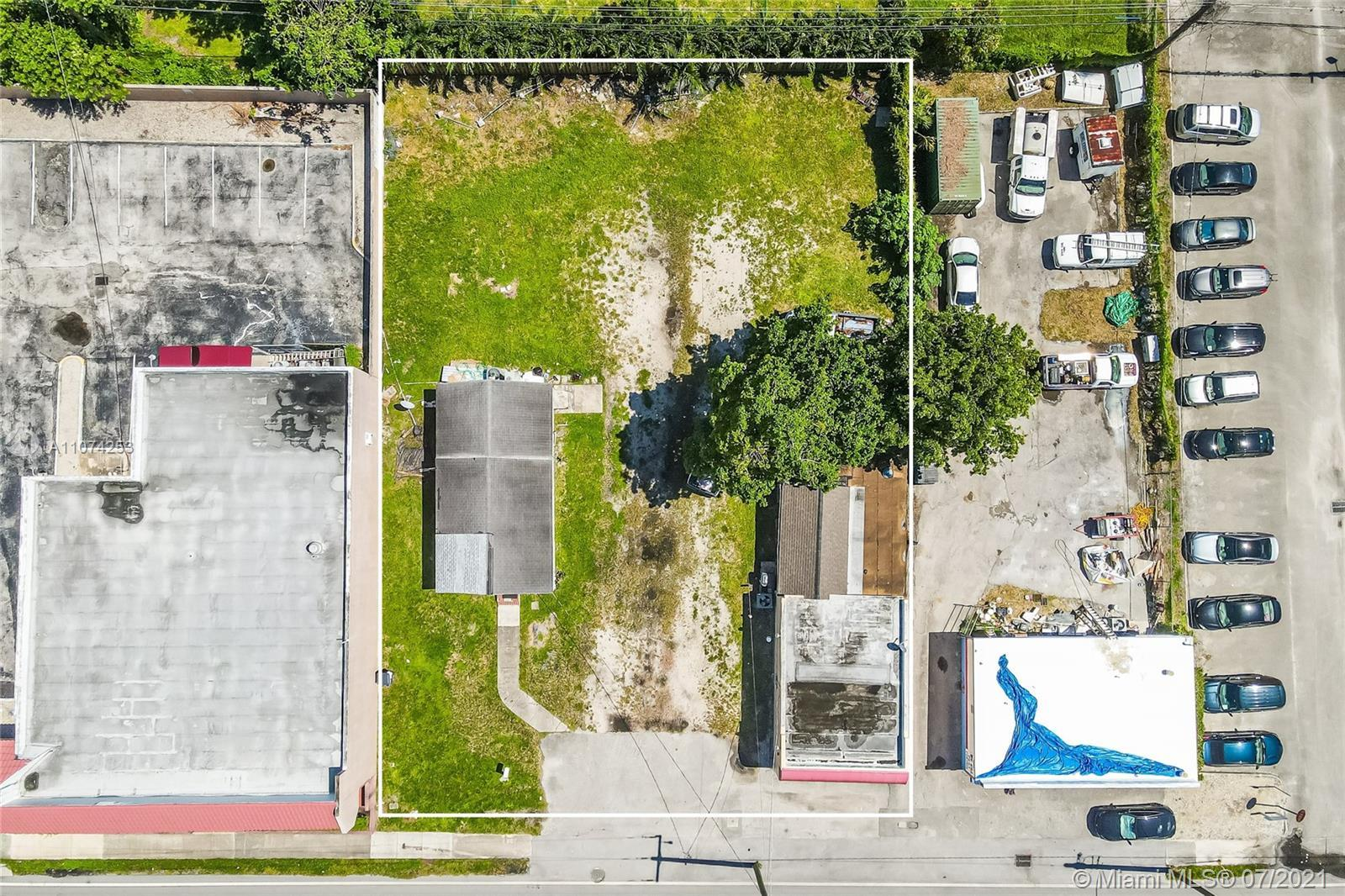"""""""A IS """" Commercial property and a Single family home on a 14,053 SQFT Lot. (One Folio) Commercial pr"""
