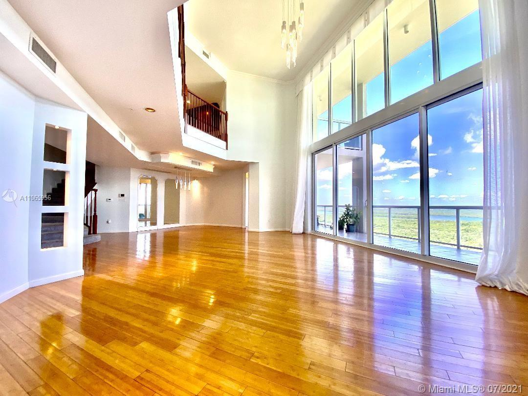 SPECTACULAR TWO STORY OCEANFRONT PENTHOUSE!!! THIS HOUSE IN THE SKY IS FEATURING DOUBLE-HEIGHT SOARI