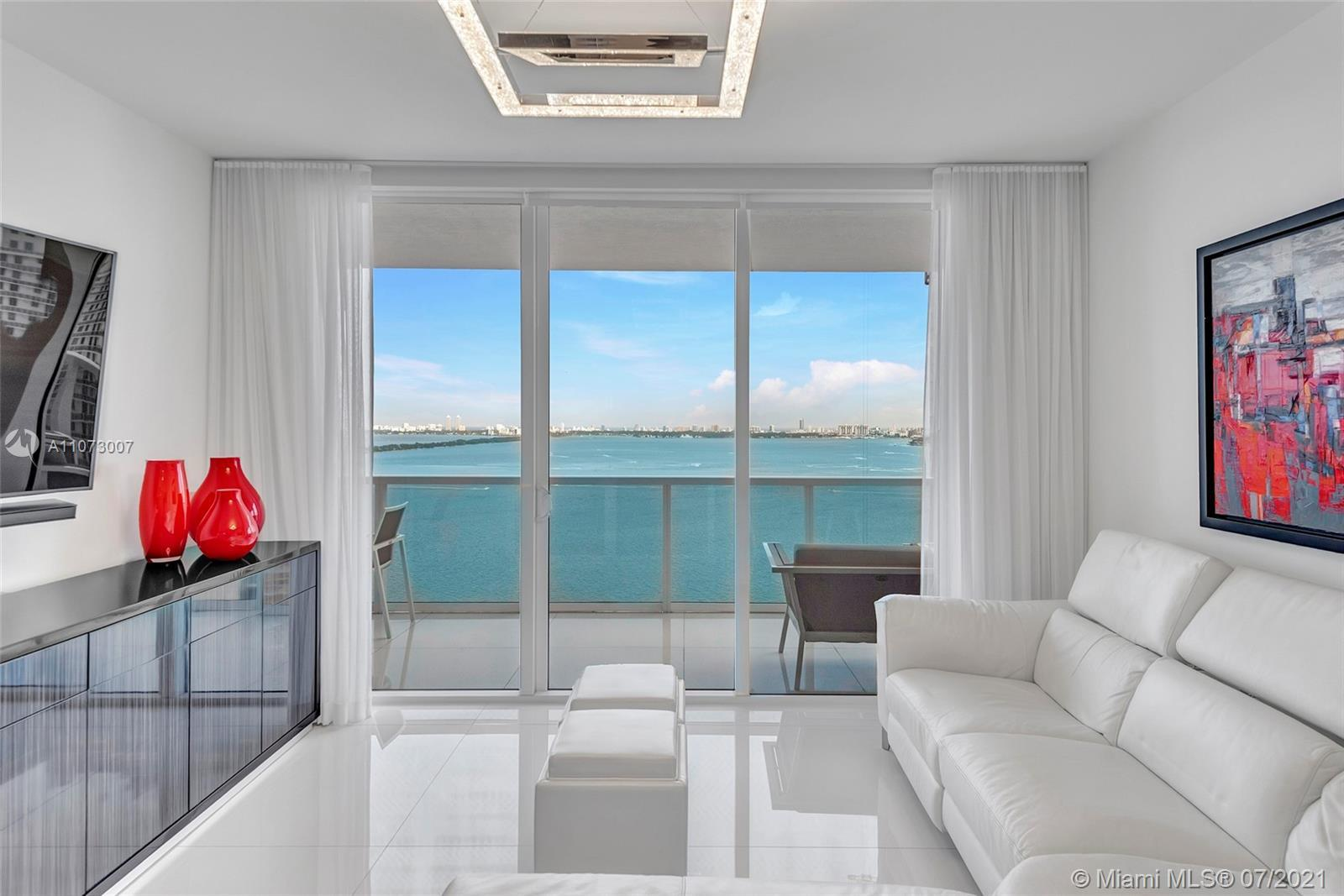 A White Masterpiece that just needs your beautiful Furniture. With it's white tile floors throughout