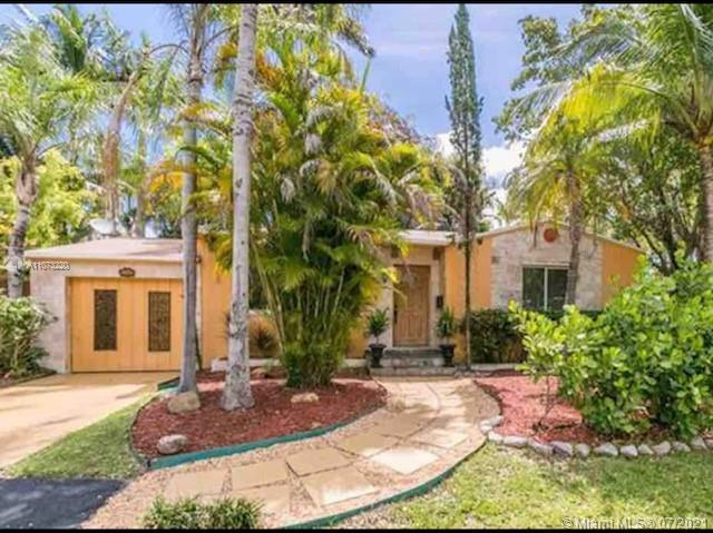 Don't miss this one of a kind home. This lushly landscaped large corner lot is perfectly located in