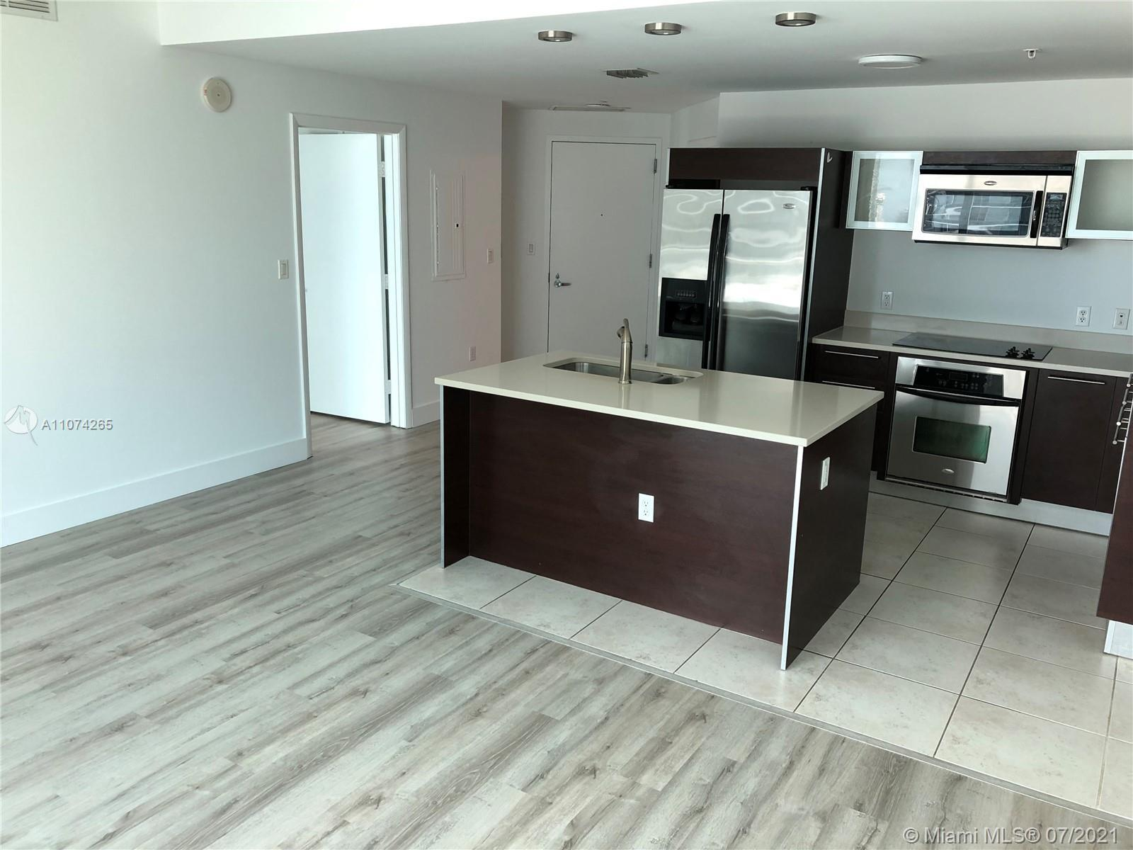 """Beautiful updated apt in Quantum on the Bay, across from the award winning, 8 acre,  """"Margaret Pace"""
