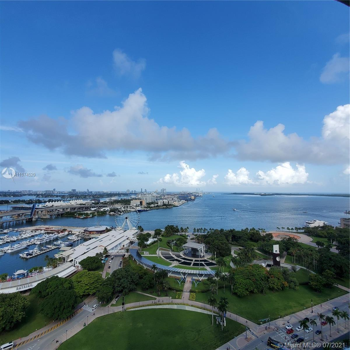 Fantastic Views from every window/balcony. Great, ample layout, 1474 sf. White porcelain floors thro