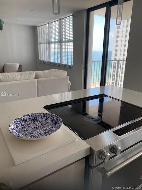 Gorgeous renovated, only model like this in the building.  Split bedrooms. Corner unit with ocean, p