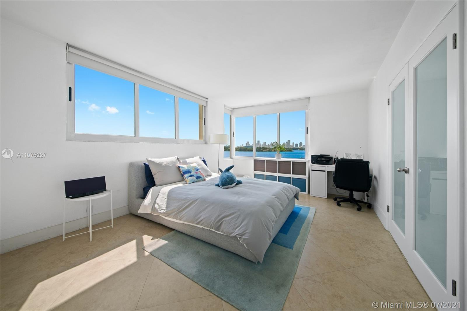Rarely available, 26-line corner unit at Mirador North Tower. Magnificent bay and downtown views fro